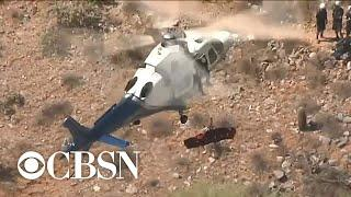 Helicopter rescue of injured woman spins out of control in Phoenix