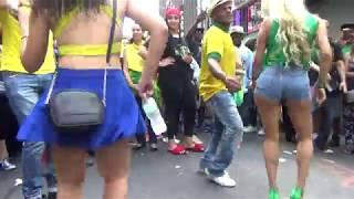 BRAZILIAN GIRLS DANCERS DANCE SAMBA AT BRAZILIAN CARNIVAL STREET PARTY