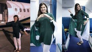 Foreigner white Girl dancing in PIA airplane weaing Pak flag