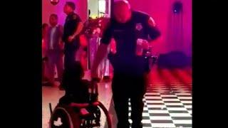 Houston cop dances with girl in wheelchair in viral video